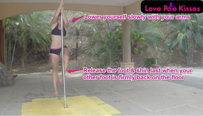 lower slowly with arms without releasing foot and shin, demo picture.